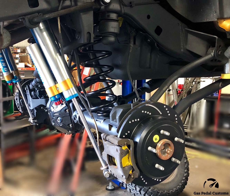 "6.4L Hemi Jeep with King shocks, Teraflex 6"" long arm suspension, and EBC brakes."